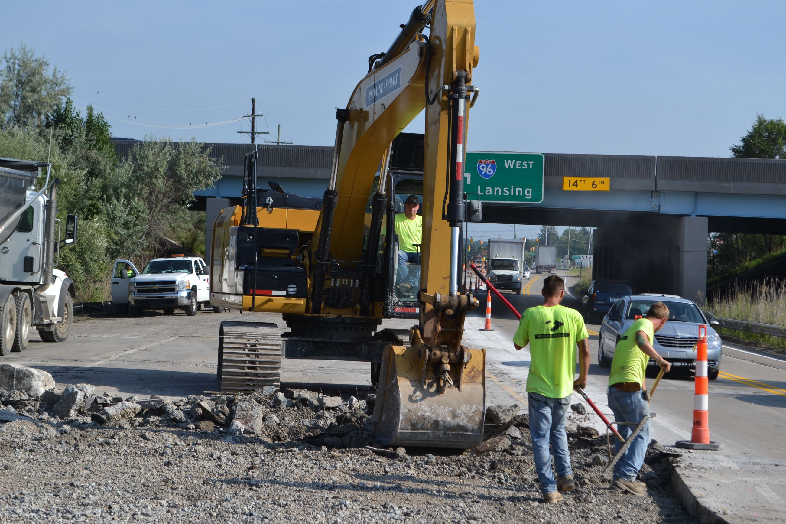 Replacing a section of Milford Road near the I-96 overpass